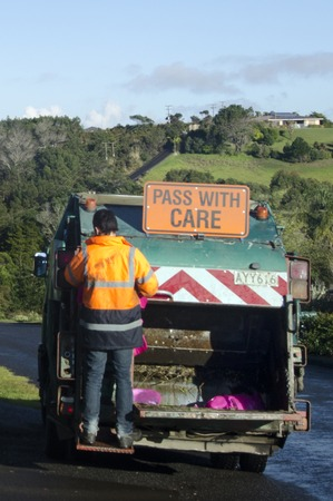 landfills: CABL BAY, NZ - JULY 25:Waste management worker on July 25 2013. The number of landfills in NZ decreased since 1995 from 327 to less than 100 today and most of New Zealand recycle is sent to China.