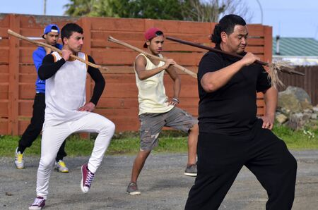 aotearoa: KAITAIA, NZ - AUG 15:Maori chief teach young men Mau Rakau martial art in the street on Aug 15 2013.Its  ancient Maori martial art that teaches the use of the Taiaha and other Maori weapons in face to face combat. Editorial
