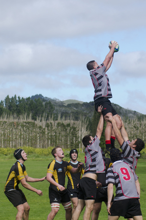 nz: KAITAIA, NZ - AUG 03: People plays Rugby on Aug 03 2013.Rugby union is the unofficial national sport of NZ. The national team, the All Blacks, rank as the top international team in the world.