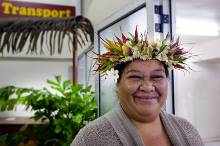 RAROTONGA - SEP 21:Exotic flowers top bouquet on Cook Islanders woman hair on Sep 21 2013.The Cook Islands' main population centres are on the island of Rarotonga 14,153 in 2006