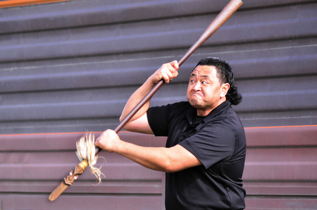 aotearoa: KAITAIA, NZ - AUG 15:Maori chief demonstrating Mau Rakau martial art in the street on Aug 15 2013.Its  ancient Maori martial art that teaches the use of the Taiaha and other Maori weapons in face to face combat. Editorial