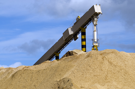 international sales: WHANGAREI,NZ - JULY 28:Pile of woodchips for export in Northport on July 28 2013. Its New Zealand third largest export earner with international sales in excess of $4 billion.