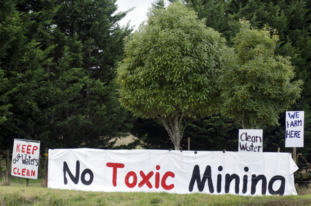 tonnes: WHANGAREI,NZ - JULY 28:No Mining protest on July 28 2013.Coal mining produced 5.3 millions tonnes of coal in 2010 but acid mine drainage from coal mining is a serious problem in New Zealand.