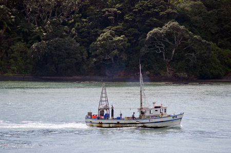 fishingboat: MANGONUI, NZ - JULY 25:Fishing boat enters Mangonui port on July 25 2013.NZ exclusive economic zone covers 4.1 million km2,Its the 6th largest zone in the world and 14 times the size of NZ.