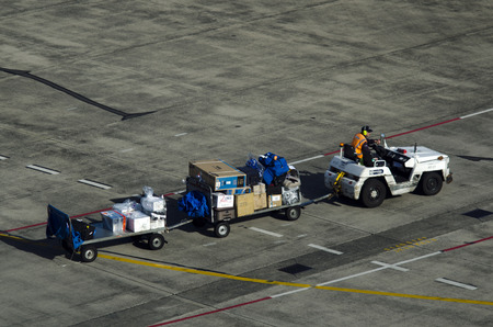 loading of cargo: AUCKLAND - SEP 15:Air transport luggage in Auckland International Airport on Sep 15 2013.Unaccompanied luggage led to downing of two flights when a bomb inside the suitcase exploded in 1985 and 1988. Editorial