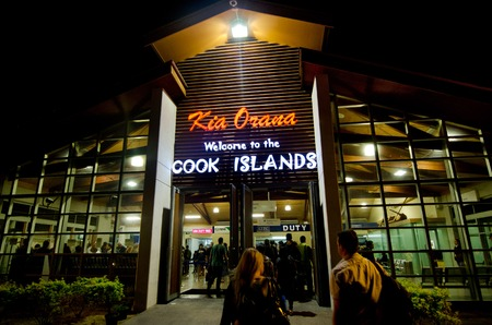 largely: RAROTONGA - SEP 15:Visitors at Rarotonga International Airport on Sep 15 2013.Cooks Islands are largely unspoiled by tourism with 100,000 visitors a year.They one of the worlds most remote Islands.