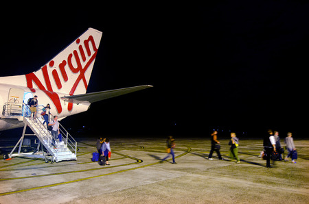 rarotonga: RAROTONGA - SEP 15:Air travelers with Virgin Australia airline arrive at Rarotonga International Airport on Sep 15 2013.Its  Australias second-largest airline. Editorial