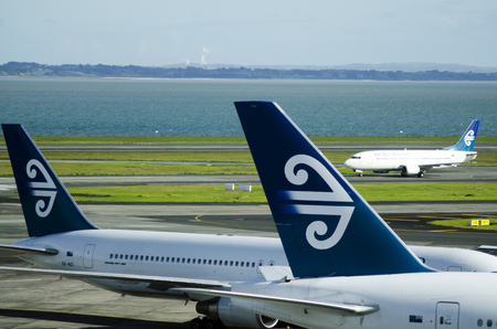 zealand: AUCKLAND - SEP 15:Air New Zealand planes in Auckland International Airport on Sep 15 2013.In 2009, the airline announced a massive drop in profits due to the global economic crisis and oil prices.