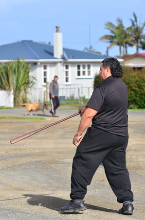 nz: KAITAIA, NZ - AUG 15:Maori chief demonstrating Mau Rakau martial art in the street on Aug 15 2013.Its  ancient Maori martial art that teaches the use of the Taiaha and other Maori weapons in face to face combat. Editorial