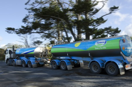 exceeding: KERIKERI, NZ - AUG 11:Fonterra Milk truck on Aug 11 2013..Fonterra responsible for 30% of the worlds dairy exports with revenue exceeding NZ$20 billion, is New Zealands largest company. Editorial