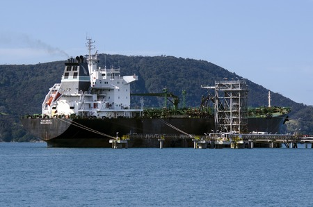 nz: WHANGAREI,NZ - JULY 28:Tanker unloading at Marsden Point Oil Refinery on July 28 2013.Its produces 70% of NZ refined oil needs, with the rest being imported from Singapore, Australia and South Korea Editorial