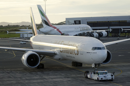 voted: AUCKLAND - SEP 15:Emirates Airline plane in Auckland International Airport on Sep 15 2013.Emirates Airline was voted Airline of the Year in 2013.