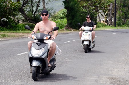 drivers license: RAROTONGA - SEP 16:Young men rides motorbikes on Sep 16 2013.Its one of the must popular activity in the Island but Cook Islands Drivers License is required to operate a motorized rental.