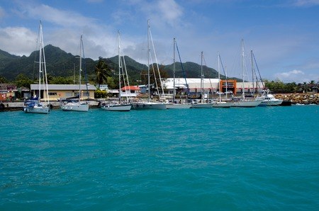 rarotonga: RAROTONGA - SEP 16:Luxury Cruises yachts moors at Port of Avatiu on Sep 16 2013.Cruising yachts are not allowed to remain in the islands during the cyclone season, which is from November to March.