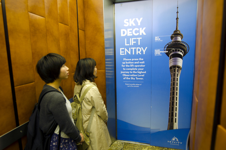 nz: AUCKLAND, NZ - OCT 08:Chines tourists visit at the Sky Tower observation deck on Oct 08 2013. According to statistics NZ China now is third largest annual visitor source to New Zealand. Editorial