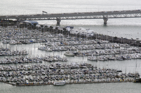 literas: AUCKLAND, NZ - OCT 08:Aerial view of Westhaven Marina on Oct 08 2013..Its the largest yacht marina in the Southern Hemisphere with nearly 2000 berths and swing moorings.