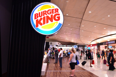 franchising: AUCKLAND - APR 10 2014: Burger King Restaurant in Auckland international airport. It is the second largest fast food hamburger chain in the world.