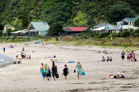nz: TAUPO BAY, NZ - JAN 24: Visitors in Taupo Bay on Jan 24 2014.Its a very popular travel destination in NZ located in east coast of Northland, New Zealand. Editorial