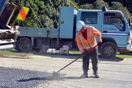 roadwork: CABLE BAY, NZ - APR 01 2014:Fulton Hogan labour.Fulton Hogan is a large infrastructure construction, roadworks company in NZ and Australasia.In 2013 its annual operating profit was NZ$96.5 million.