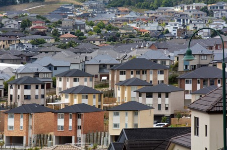 in the suburbs: AUCKLAND,NZ - JAN 11:New Homes on JAN 11 2014.House prices are booming around New Zealand - with the average price of an Auckland city home rocketing to 735,692.