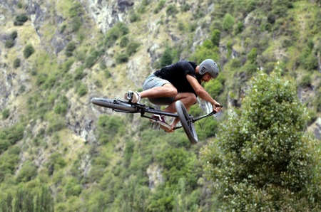 bmx bike: QUEENSTOWN, NZ - JAN 14:Young man performing tricks and stunts with his BMX Bike on Jan 14 2014 in Queenstown,NZ. BMX stands for Bicycle Motocross and its known as a extreme sport.