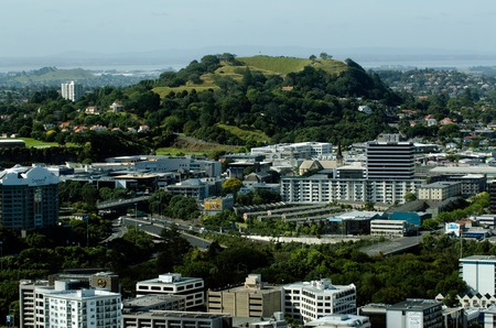 nz: AUCKLAND,NZ - JAN 02:Aerial view of Mount Eden on Jan 02 2014.The volcano mountain is the highest natural point on the Auckland isthmus. (196 metres above sea level).