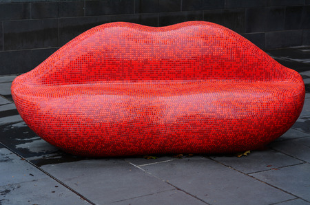womanliness: MELBOURNE - APR 11 2014: Red Mosaic Lips in Southbank Melbourne, one of the primary business centers and also one of the most densely populated areas of Greater Melbourne. Editorial