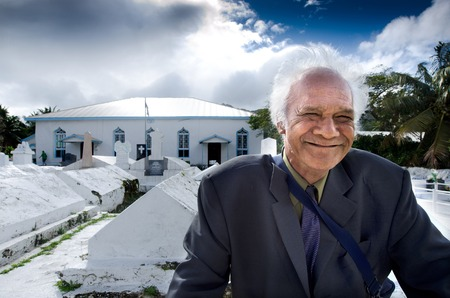 RAROTONGA - SEP 16:Cook Islander Man outside Arorangi CICC Church on Sep 16 2013.94% of Cook Islanders associated themselves with a faith.The Cook Islands Christian Church (CICC) dominant with 49% (7,356) members. Editorial
