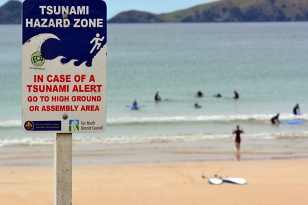 impacted: TAUPO BAY, NZ - FEB 14:Tsunami hazard zone sign on Feb 14 2014.NZ was hit by 15m high tsunami in the 15th Century and in last 150 years four tsunami events have impacted Northland east coast. Editorial