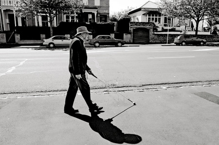 shortsighted: AUCKLAND - OCT 06:Blind man walks with a cane on Oct 06 2013.According to WHO, 90% of blind people live in the developing world AND cataract is responsible for more than 22 million cases of blindness.