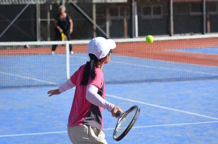 wimbledon: KAITAIA, NZ - MAR 06: Women play tennis on Mar 06 2014.The first women to play in the Wimbledon tournament wore full length dresses