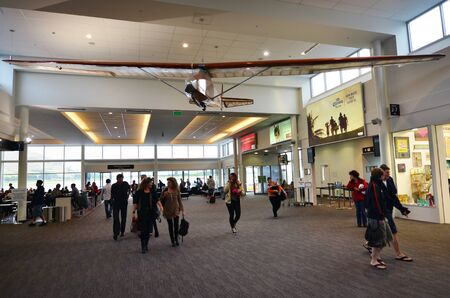 nz: QUEENSTOWN, NZ - JAN 18:Passengers in Queenstown Airport on Jan 18 2014.Its the fourth busiest airport in NZ by passenger traffic handled 924,248 airline scheduled passengers in 2011.