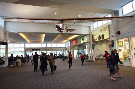 handled: QUEENSTOWN, NZ - JAN 18:Passengers in Queenstown Airport on Jan 18 2014.Its the fourth busiest airport in NZ by passenger traffic handled 924,248 airline scheduled passengers in 2011.