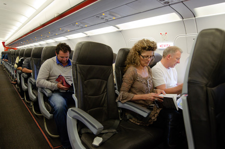 AUCKLAND - JAN 12: Interior of airplane with passengers on seats on Jan 12 2013.The annual risk of being killed in a plane crash is 1 in 11 million.