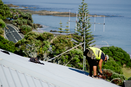 scaffolds: CABLE BAY,NZ:Roofer fixing a leaking roof on Dec 12 2013. In 2000, 717 workers died of injuries caused by falls from ladders, scaffolds, buildings, or other elevations.