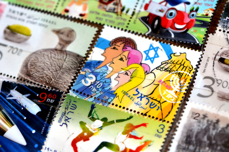 proclaimed: JERUSALEM, ISR - MAR 15 2014:Collection of Israeli stamps made by the Israel Philatelic Service.Israeli postage stamps issued by the state of Israel since independence was proclaimed on May 14, 1948.