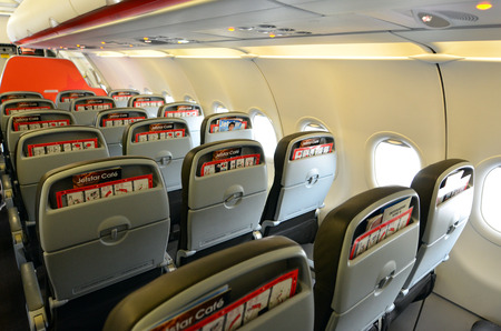 generates: AUCKLAND - JAN 12: Interior of empty airplane on Jan 12 2013.The airline industry, worldwide,  generates about $640 billion.