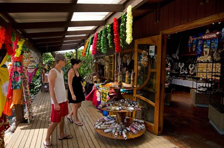 to prefer: RAROTONGA - SEP 21:Young couple looking for a gift in a souvenir shop on Sep 21 2013.New study finds 76 percent of women prefer in-store shopping and most men hate to shop. Editorial