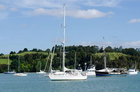 sheltered: OPUA, NZ - DEC 12:Opua marina on Dec 12 2013.Its a 250-berth Marina, popular destination for cruising yachts owing to its sheltered, deep water anchorage, and numerous facilities for cruisers.