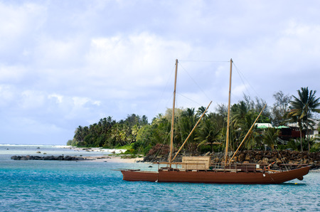 doubled: RAROTONGA - SEP 21:Doubled hulled vaka in Rarotonga on Sep 21 2013.The first sailing canoes emerged in ancient Polynesia over 1,000 years ago. Editorial