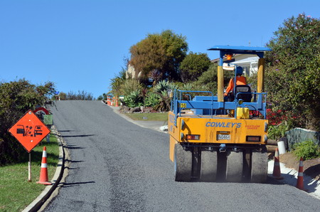 vibroroller: CABLE BAY, NZ - APR 01 2014:Road roller on asphalt pavement works (road repairing). There are more than four million miles of highways and roads in the U.S alone.