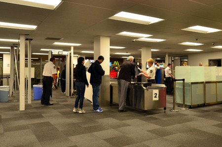 checkpoint: AUCKLAND - DEC 31:Airport security station on Dec 31 2013.Since the 1970s, Air Terrorism, hijackings and bombings became the method of choice for subversive, militant organizations around the world.
