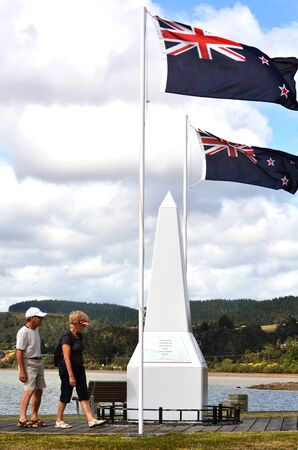 cross armed: MANGONUI, NZ  - MAR 12 2014:New Zealander couple visit a national War Memorial.Over 18,000 New Zealand soldiers were killed in the First World War.