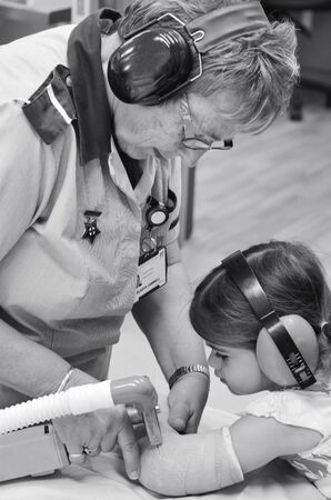 surgical removal: KAITAIA, NZ  - MAR 27 2014:Nurse removing an arm orthopedic cast of a child (Talya Ben-Ari age 3). Forearm fractures account for 40% to 50% of all childhood fractures.(BW)) Editorial