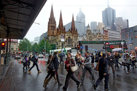 tourist attraction: MELBOURNE, AUS - APR 10 2014:Traffic on Swanston Street and Federation Square.Melbourne have population and employment growth with international investment in the citys industries and property market