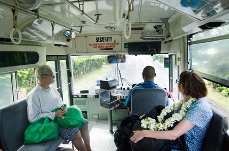 rarotonga: RAROTONGA - SEP 17:Passengers travel by the Cook Islands public bus on Sep 17 2013.The round-Rarotonga bus service runs clockwise and anti-clockwise on the main 32km  ring road around Rarotonga Island.