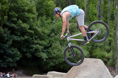 bmx bike: QUEENSTOWN, NZ - JAN 14:Young man is jumping with his BMX Bike on Jan 14 2014 in Queenstown,NZ. It became official Olympic sport in the 2008 Summer Olympic Games in Beijing, China.