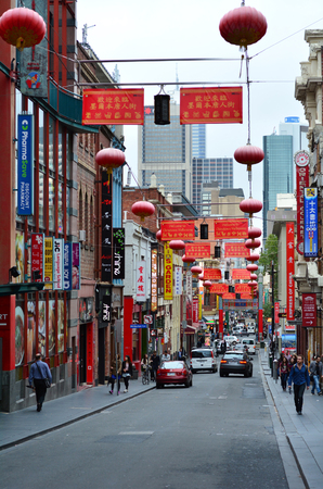 inception: MELBOURNE, AUS - APR 11 2014:Traffic on Melbourne Chinatown.Since its inception in 1854 and the arrival of Chinese immigrants to Melbourne, Chinatown become a major tourist attraction in Melbourne.