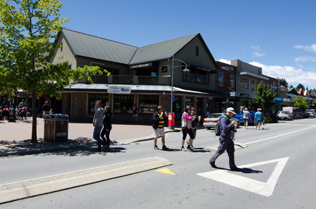 nz: WANAKA, NZ - JAN 17: Visitors in Wanaka town on Jan 17 2014.Wanaka is a very popular resort town in NZ for both summer and winter seasons  sports and outdoor activities. Editorial