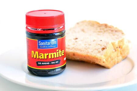 sanitarium: AUCKLAND, NZ - MAR 31 2014:A jar of Marmite produced by Sanitarium Health and Wellbeing Company.Its on of the  top-seller in the Australian and New Zealand breakfast food market.
